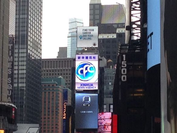 A Xinhua billboard in Times Square. Japanese companies are no longer as prominent as they used to be.
